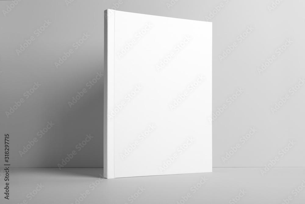 Fototapeta Real photo blank portrait A4, US-Letter, brochure magazine mockup isolated on gray background.