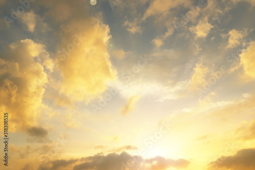fototapeta na szkło Sunset over the village. Dramatic coloring of the evening sky with cumulus clouds. Golden range of colors of nature. Prediction of changing weather conditions. Romantic mood. Black silhouette