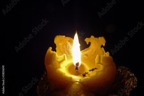 Burning Christmas candle cast from beeswax Wallpaper Mural