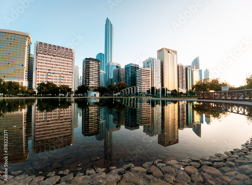 Abu Dhabi downtown reflected in the water at the Lake park Wallpaper Mural