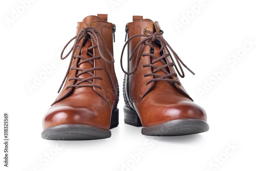 Pair of brown leather womens boots on the white background isolated Wallpaper Mural