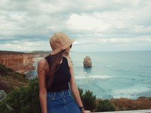WoMAN WEARING HAT AGAINST SEA AGAINST SKY