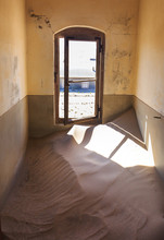 Abandoned And Forgotten Building And Room Left By People And Being Taken Over By Encroaching Sandstorm, Kolmanskop Ghost Town, Namib Desert