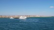Yacht and motor boat at the pier. The shore of the Red Sea. View from the sea
