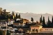 SPANISH CITYSCAPE AGAINST MOUNTAIN