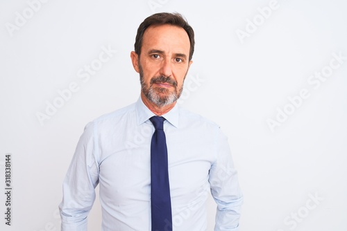 Fototapety, obrazy: Middle age businessman wearing elegant tie standing over isolated white background Relaxed with serious expression on face. Simple and natural looking at the camera.