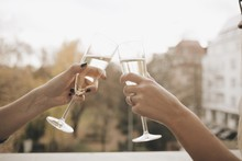 Cropped Hands Hand Toasting Champagne Flutes