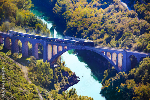 famous solkan bridge with the train