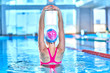 Leinwanddruck Bild - Fit active woman doing water gymnastics and aerobics in a sports swimming pool in leisure center. Pool workout, treatment and prevention of back and neck disease, healthy back