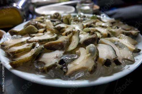 Obraz na plátně Close-Up Of Conch With Ice On Plate