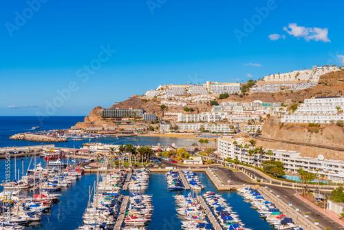 Fotografie, Obraz Coastal village of Puerto Rico Gran Canaria Spain