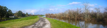 Paved Bike Path On Top Of Earthen Dike Levee Along Mississippi River In Louisiana