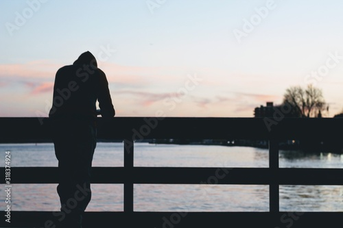 Stampa su Tela Rear View Of Silhouette Man Standing On Pier Over Sea