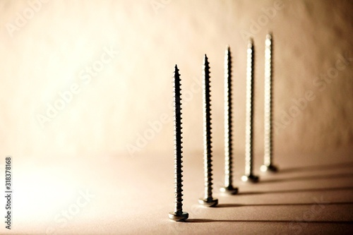 Obraz Close-Up Of Screws On Table - fototapety do salonu