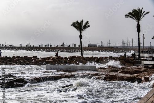 Big waves are splashing at the pier Wallpaper Mural