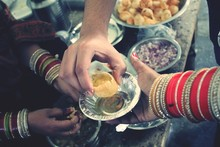 Cropped Hand Of Woman Taking Panipuri From Vendor