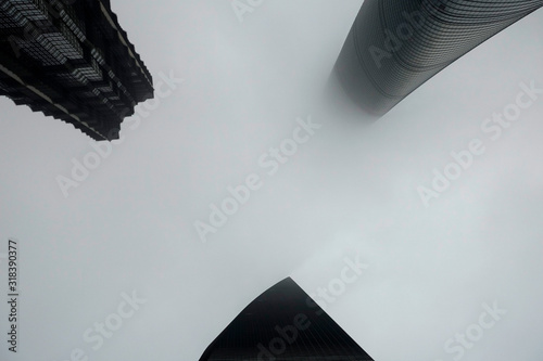 Fototapeta Directly Below Shot Of Buildings Against Sky During Foggy Weather obraz na płótnie