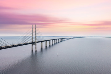 Fototapeta Mosty The Oresund bridge between Copenhagen Denmark and Malmo Sweden when sunset in an evening of May
