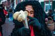 fastnachtsgestalt - gayser gilde obereschach - gestalt mit gekräuselten haaren zeigt gegenstand - fastnachtsumzug - ettenheim - southern germany