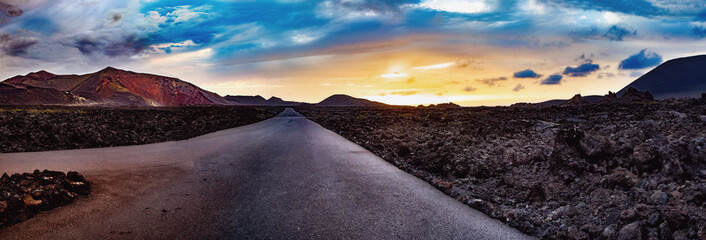 Image related to unexplored road journeys and adventures.Road through the scenic landscape to the destination in Timanfaya natural park in Lanzarote,Canary island,Spain