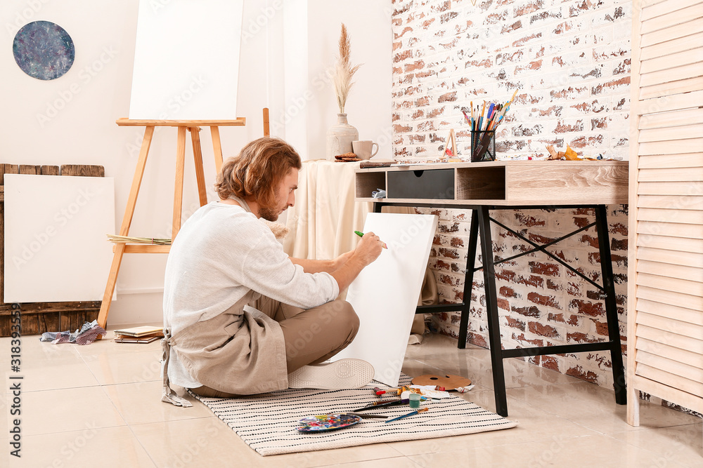 Fototapeta Young male artist painting at home