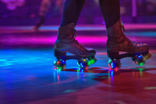 LOW SECTION OF Person Wearing Roller Skates
