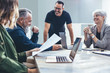 Leinwandbild Motiv Business people smiling during a meeting