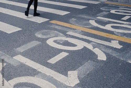 Obraz na plátně Low Section Of Person Walking On Road With Markings