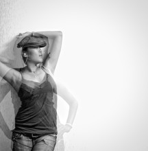 Double Exposure Image Of Woman Posing By White Wall