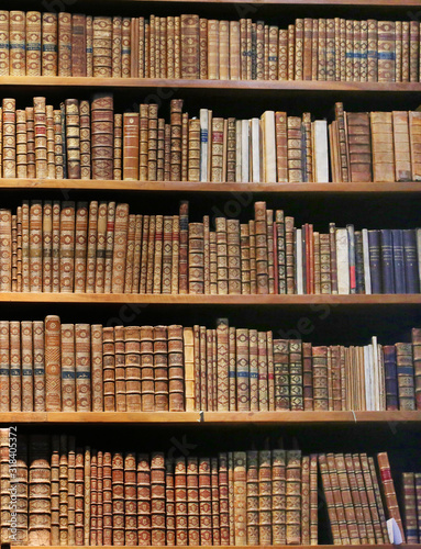 antique books on wooden shelf