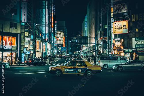Fototapeta VIEW OF CITY STREET AT NIGHT obraz