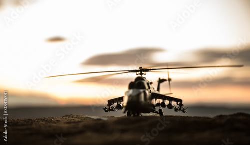 Silhouette of military helicopter ready to fly from conflict zone Wallpaper Mural