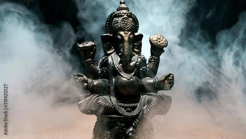 Hindu god Ganesha on black background Canvas Print