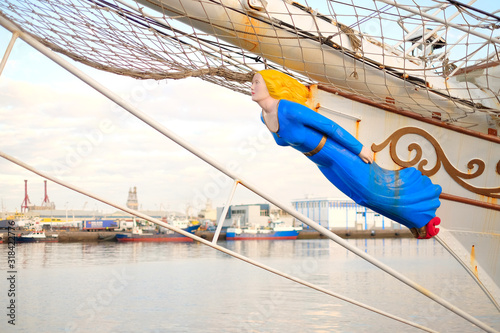 A figurehead of a classic sailing ship, a carved wooden female figure decorating the bow Fototapeta