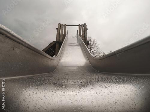 Low Angle View Of Wet Slide Against Sky - fototapety na wymiar