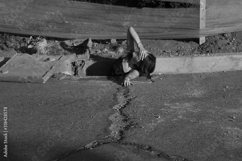 High angle view of woman covering eyes in Gutter by road Canvas Print