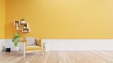 Living Room Interior With Yellow Fabric Armchair,lamp,book And Plants On Empty Yellow Wall Background.