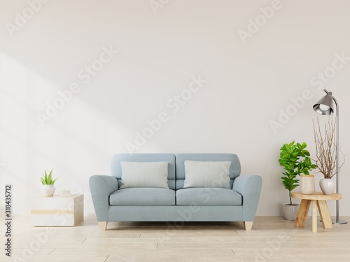 Fototapeta Modern living room interior with sofa and green plants,lamp,table on white wall background. obraz na płótnie