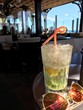 Close-Up Of Drink And Sunglasses On Table At Restaurant