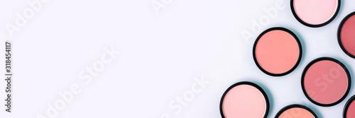 Valokuvatapetti Pink blush and compact powder on a pastel blue background