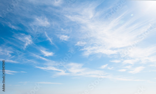 Blue sky with clouds over the horizon - 318470141