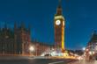 Illuminated Street By Big Ben In City At Night