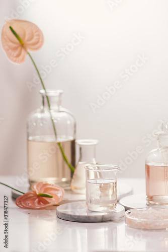 Fototapeta Bottles with different perfume oils on table obraz