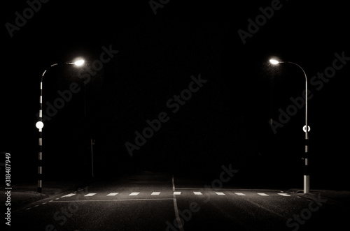Fototapeta Illuminated Street Lights Against Sky At Night obraz