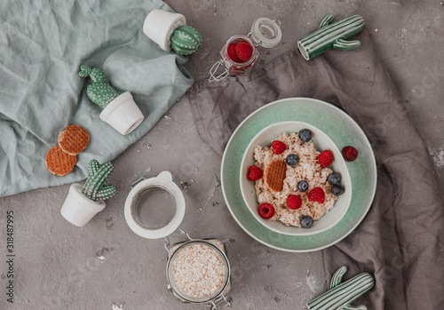 Fototapeta Delicious healthy breakfast - granola with berries on the table. Copy space, top view, flat lay obraz