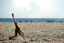 Boy Doing Cartwheel On BEACH A...
