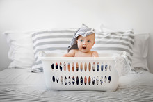Funny Baby Sitting In A Laundr...