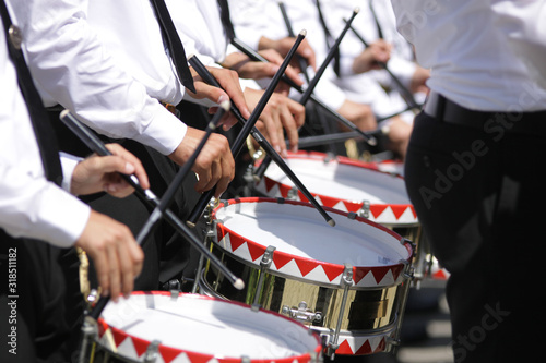 Obraz na plátne Midsection Of Musicians Playing Drum