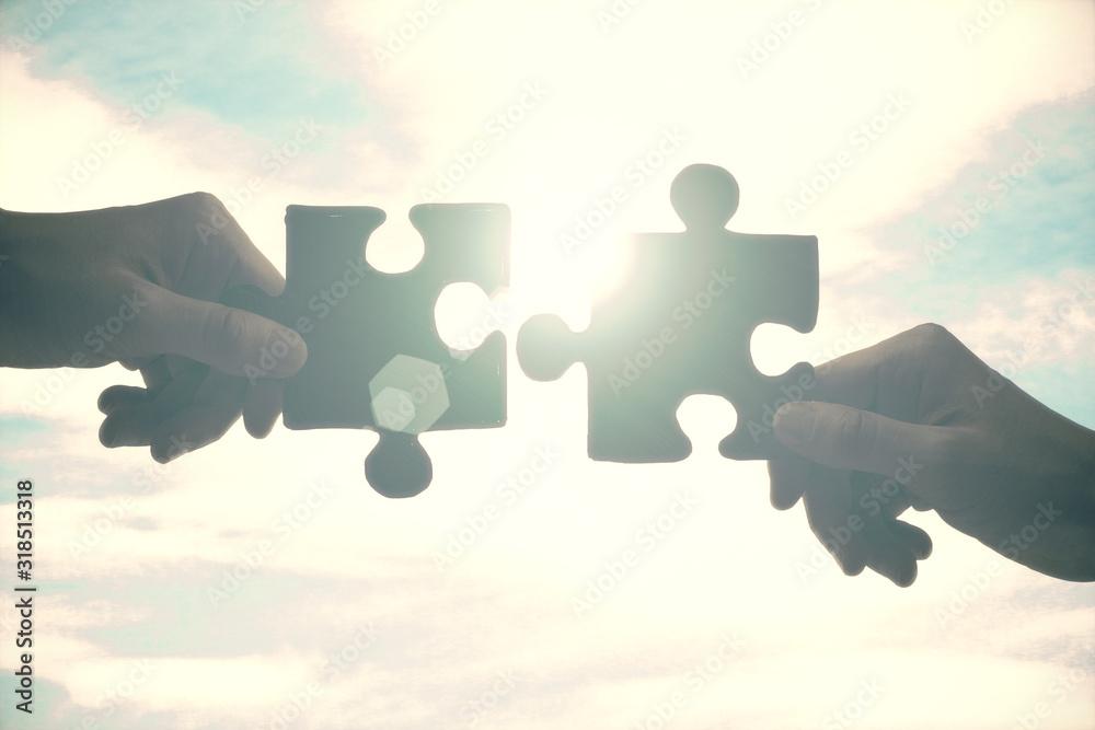 Fototapeta Hands putting puzzle pieces