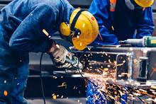 Worker Grinding In A Workshop. Heavy Industry Factory